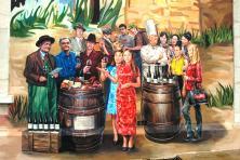 La fresque symbolise la renommée mondiale des vins du Beaujolais et leur vocation de plaisir partagé